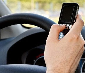 driver on holding a cell phone